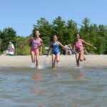 Kids playing in the water at Wasaga Beach