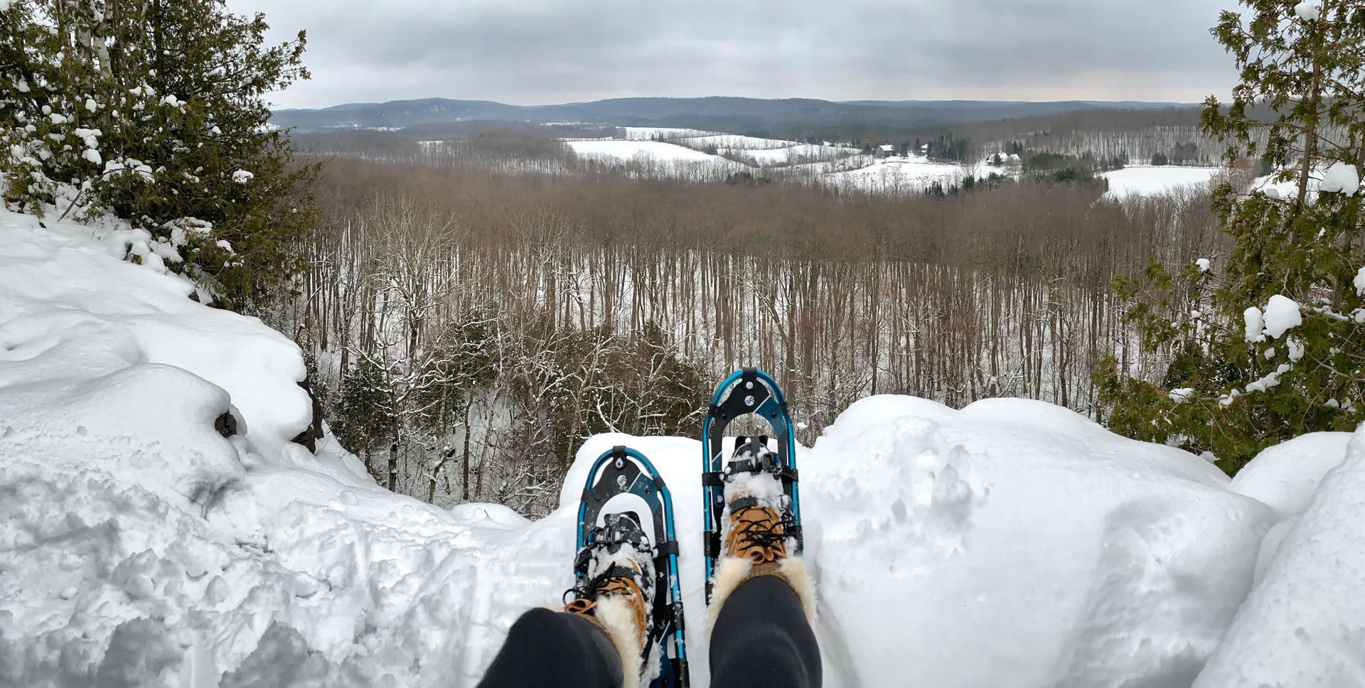 Snowshoeing and overlooking Nottawasaga Bluffs